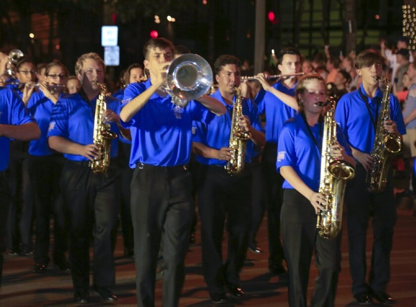 Members of the Valhalla High School marching band make their way in a parade honoring Pearl Harbor survivors on Dec. 7 in Hawaii.