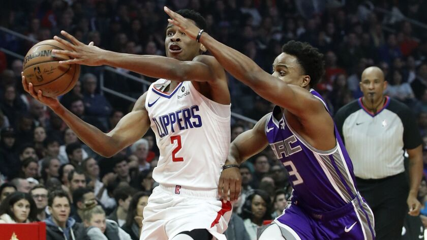 LOS ANGELES, CALIF. - DEC. 8, 2018. Clippers guard Shai Gilgeous-Alexander drives to the basket ag