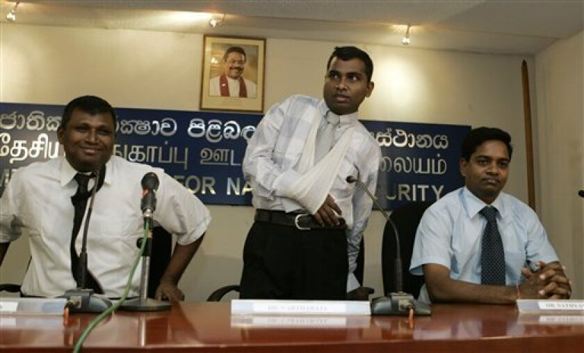 Sri Lankan ethnic Tamil doctors from left, V. Shanmugarajah, Thurairaja Varatharajah, and Thangamuttu Sathyamurthi prepare to address the media in Colombo, Sri Lanka, Wednesday, July 8, 2009. A group of Sri Lankan doctors who worked in the war zone and have been in police custody for nearly two mon