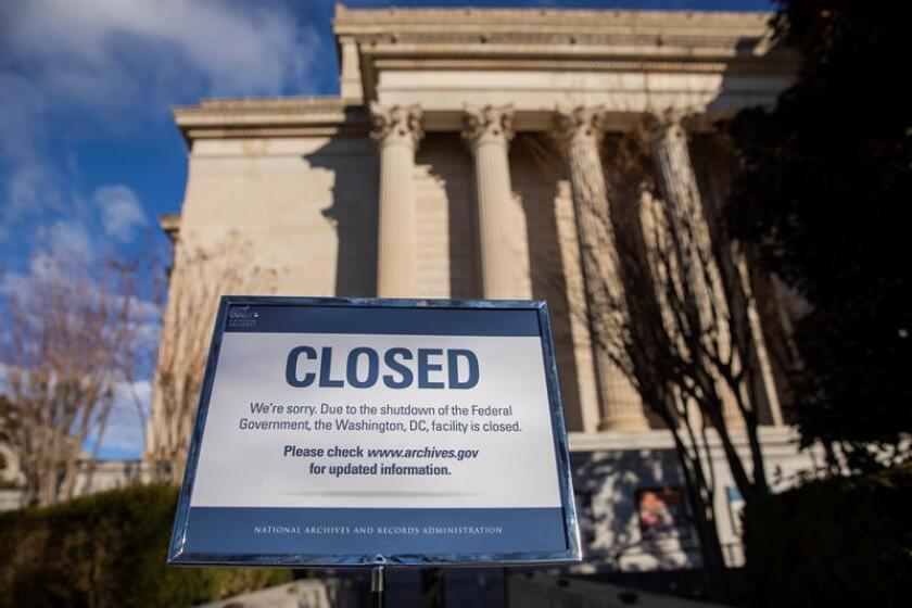 A sign announces the closure of the National Archives building in Washington, DC, USA, on Dec. 22, 2018. A partial US government shutdown began on Dec. 22 when Congress was unable to reach agreement on a funding deal. EPA-EFE/ERIK S. LESSER