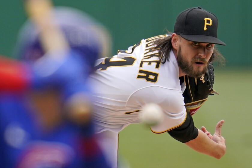 Pittsburgh Pirates starting pitcher JT Brubaker delivers during the first inning of a baseball game against the Chicago Cubs in Pittsburgh, Sunday, April 11, 2021. (AP Photo/Gene J. Puskar)