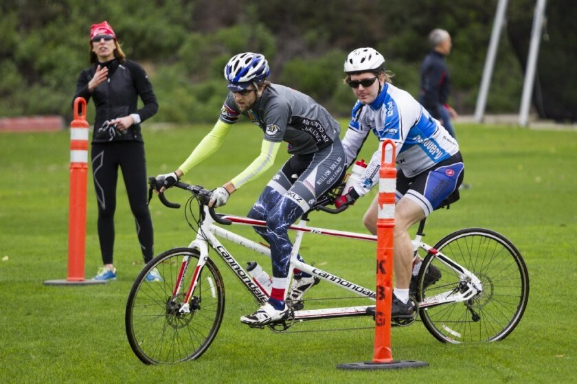 Guide Danny Craven and deaf and blind paratriathlete Patrick Vellia navigate a course during training.