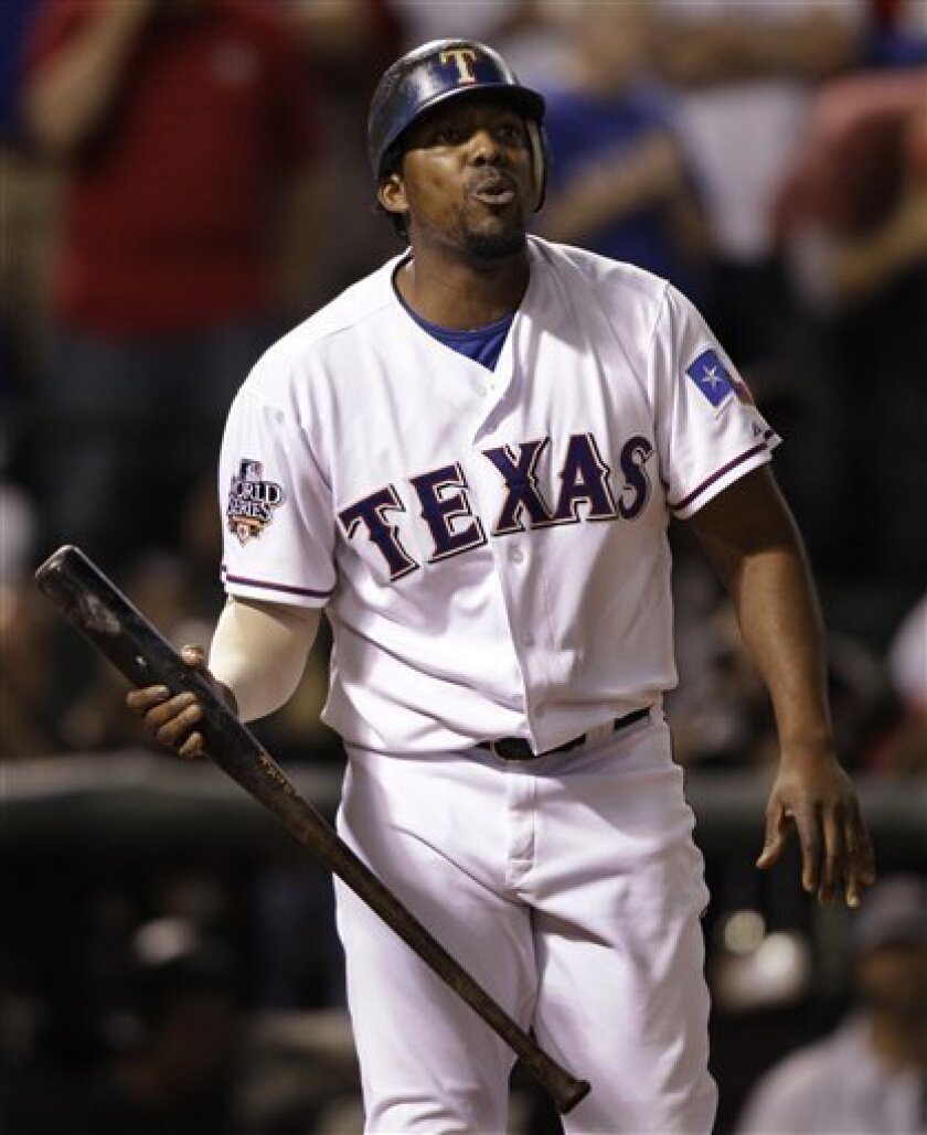 Texas Rangers' Vladimir Guerrero reacts after striking out during the seventh inning of Game 4 of baseball's World Series against the San Francisco Giants Sunday, Oct. 31, 2010, in Arlington, Texas. (AP Photo/David J. Phillip)