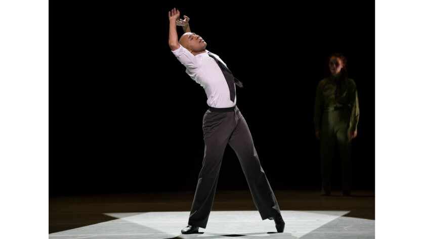 "Matthew Rushing performs ""r-Evolution, Dream."" The piece is one of nine dances to be performed in rotation Wednesday through Sunday when Alvin Ailey American Dance Theater comes to the Music Center."