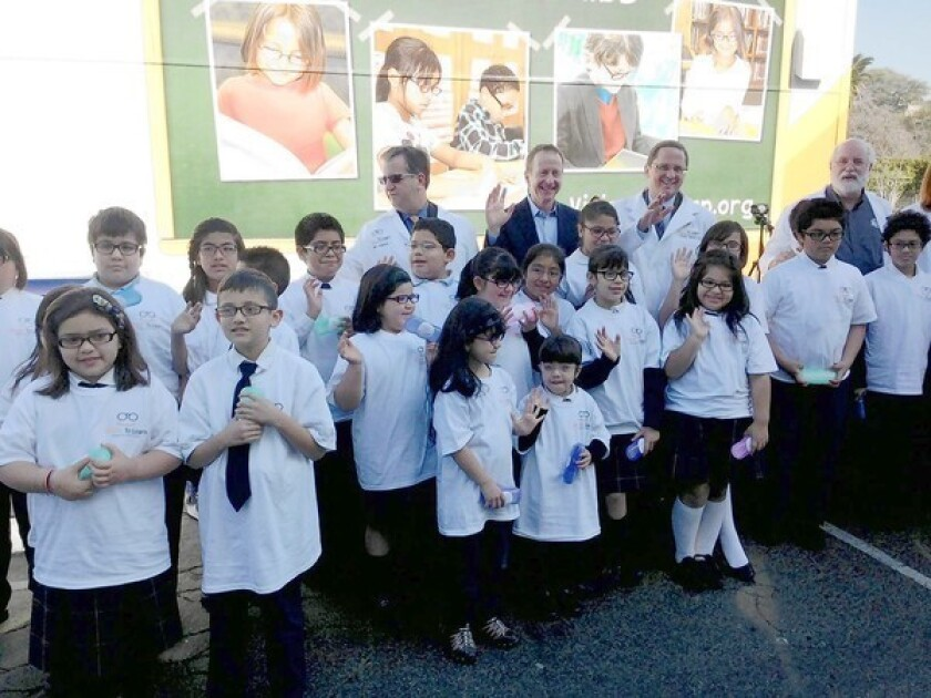 Students at Dolores Mission School in Boyle Heights get free eyeglasses from Vision to Learn, a nonprofit established by Austin Beutner, third from right in the back row.