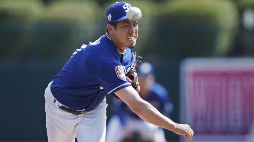 Dodgers starting pitcher Kenta Maeda pitches in the second inning of a spring training game against the Seattle Mariners on Saturday in Phoenix.