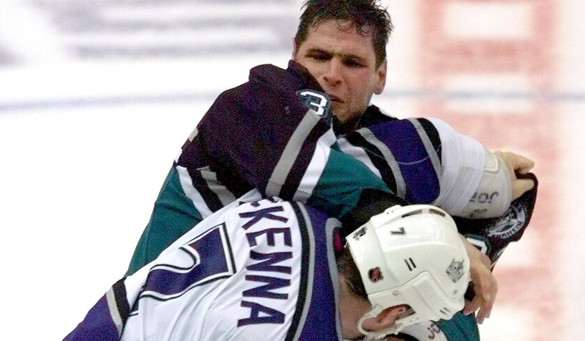 Stu Grimson of the Ducks and Steve McKenna of the Kings trade punches during the early days of their co-existence. The looming playoff series could heighten the nature of their rivalry.