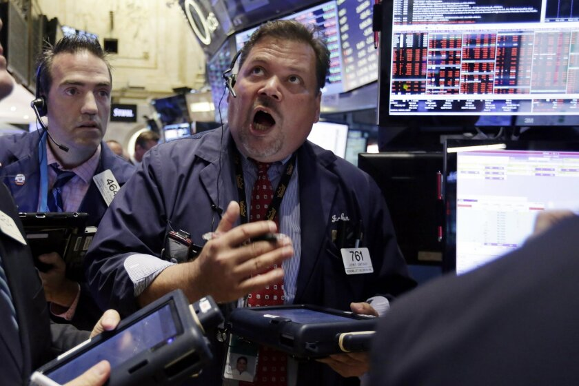 A trader works on the floor of the New York Stock Exchange in this 2015 photo.