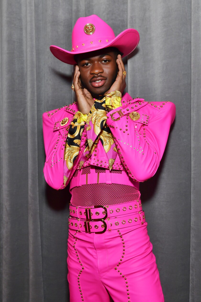 2020 Grammys: Lil Nas X turns heads in a hot-pink Versace outfit on the red carpet