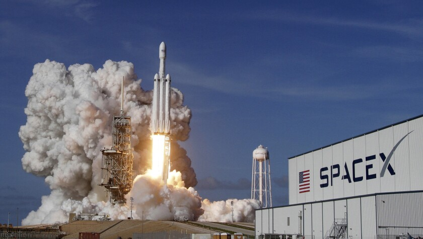 A SpaceX Falcon Heavy rocket lifts off in Cape Canaveral, Fla., in February 2018.