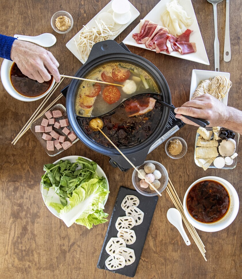 To enjoy Sichuan hot pot, diners choose an item, swish it in a flavorful broth until it is cooked, then eat.