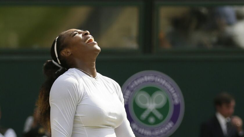 Serena Williams of the United States celebrates defeating Germany's Julia Gorges in their women's si