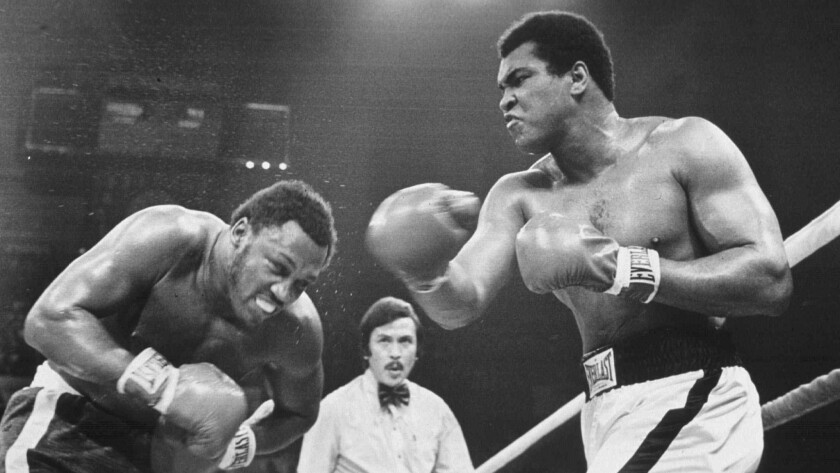 "Muhammad Ali, right, and Joe Frazier fight for the third time on Oct. 1, 1975, during their ""Thrilla in Manila."""