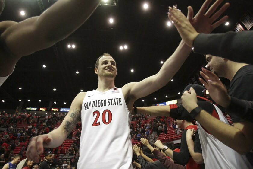 SAN DIEGO, February 13, 2016 | The Aztecs' Matt Shrigley is congratulated by fans after the Aztecs beat Air Force 70-61 at the Viejas Arena in San Diego on Saturday. | -Mandatory Photo Credit: Photo by Hayne Palmour IV/San Diego Union-Tribune, LLC