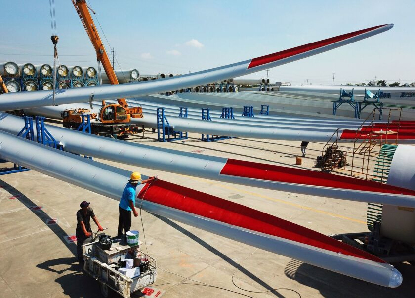 Workers check the quality of newly manufactured wind turbine blades at a factory in Lianyungang, China, on July 31, 2018. President Trump is considering levying even more tariffs against Chinese goods.
