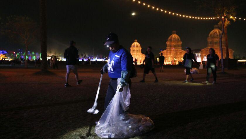 INDIO-CA-APRIL 21, 2018: Music fans linger amongst the trash and water bottles left behind after Bey