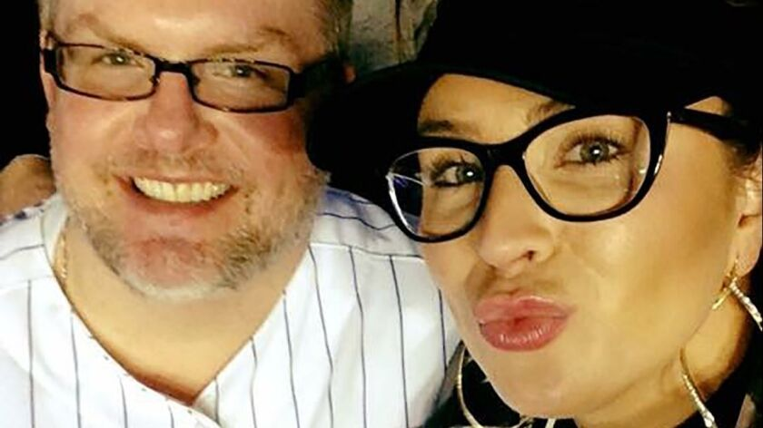 Scott Kennedy with Crystal Lundberg at a Cubs game in 2015. Scott was a Buffalo Grove business execu
