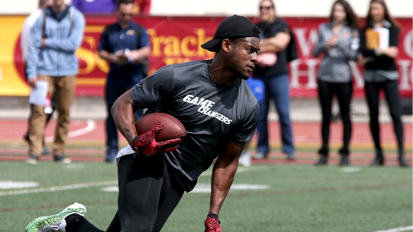 Wide receiver JuJu Smith-Schuster runs a drill during USC's pro day on Wednesday.