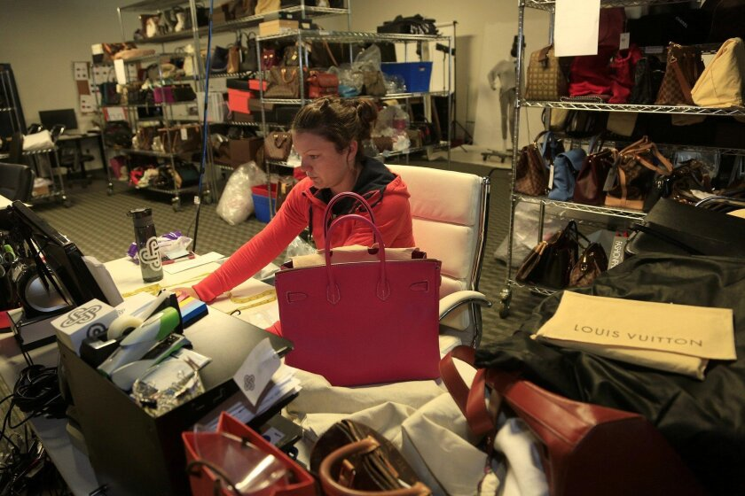 Fashionphile employee Danielle Whited registers a Hermès Birkin bag that was sold to the Carlsbad location.