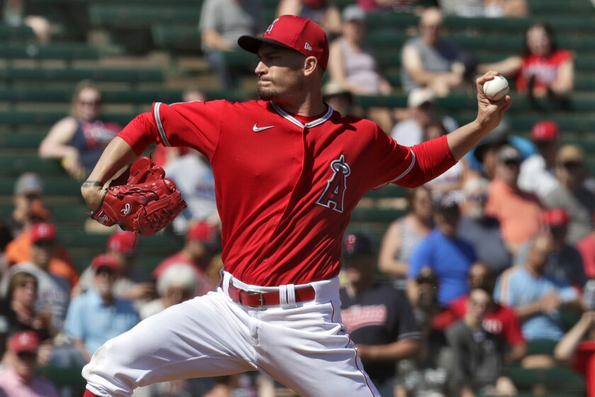 Angels pitcher Andrew Heaney throws during the first inning of a spring training game against the Cleveland Indians.