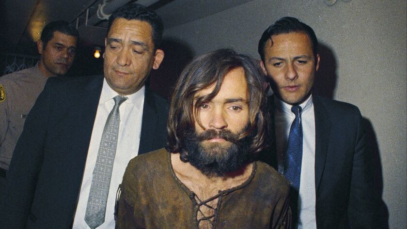 Charles Manson is escorted to his arraignment on conspiracy-murder charges in 1969 in connection with the Sharon Tate murder case.