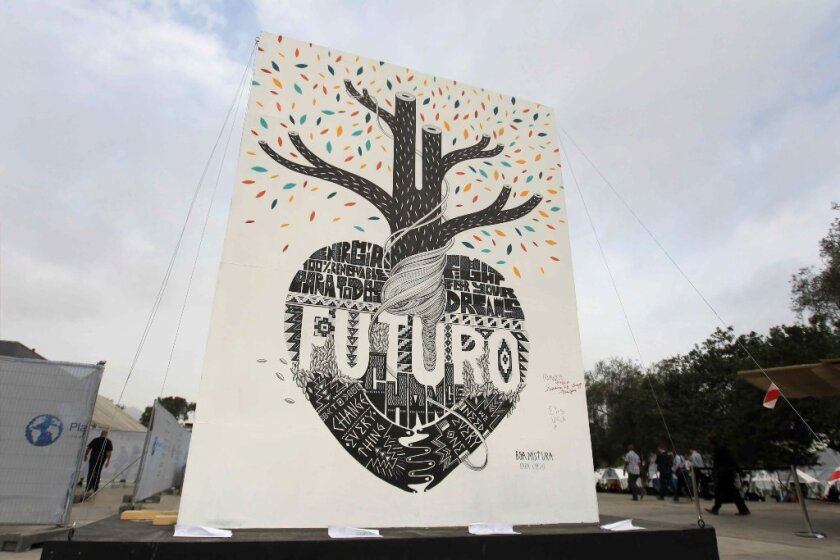 "Graffiti art titled ""Future,"" advocating renewable energy and other action against global warming, is exhibited during the U.N. Climate Change Conference in Lima, Peru, on Dec. 12."