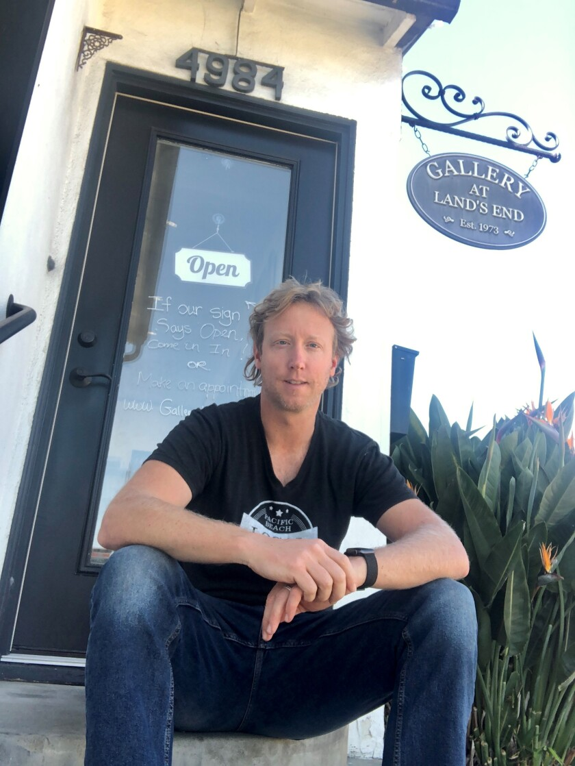 Thayne Yungman at his Pacific Beach shop, Gallery at Land's End, which has framing services as well as gifts and goods.