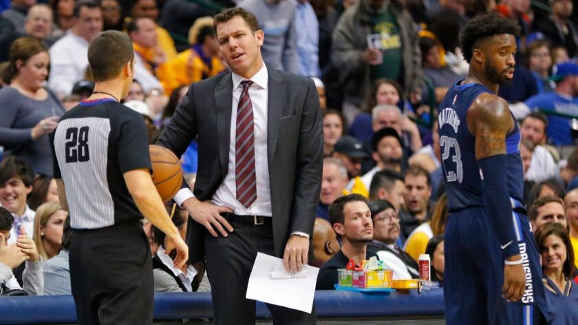 Lakers head coach Luke Walton argues with referee Kevin Scott (28) over a foul call in the third quarter against the Dallas Mavericks on Saturday.