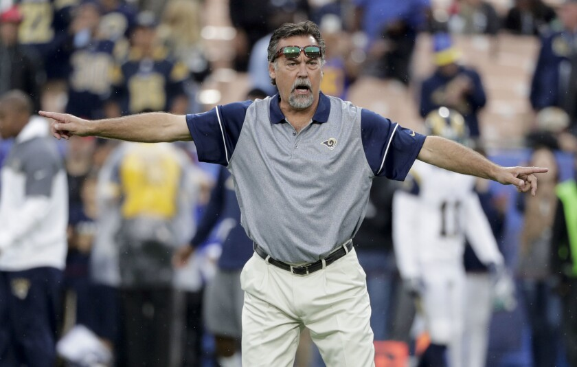 Rams Coach Jeff Fisher watches during warmups before a game against the Miami Dolphins on Nov. 20.