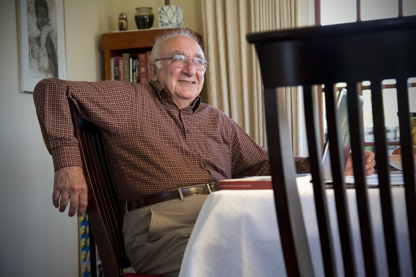 Sam Halpern in the dining room of his Point Loma home, where he does most of his writing.