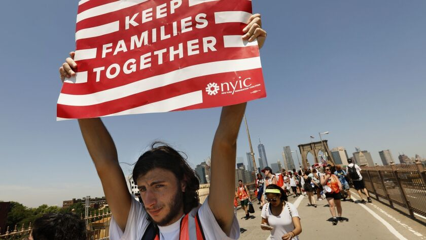"""Ariel Schwartz, 19, of Long Island, N.Y., takes part in the march to """"Keep Families Together"""" in June in New York."""