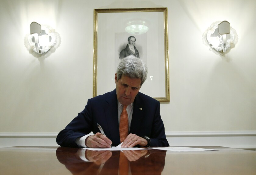 U.S. Secretary of State John Kerry signs a series of documents in Vienna, Austria. U.S. Secretary of State, John Kerry confirms Iran in compliance with nuclear deal and lifts US nuclear-related sanctions.