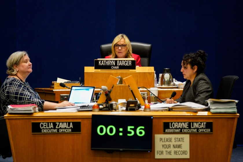 Seated center, Supervisor Kathryn Barger listens to testimony during a Board of Supervisors meeting where Los Angeles County elections chief Dean Logan testified Tuesday.