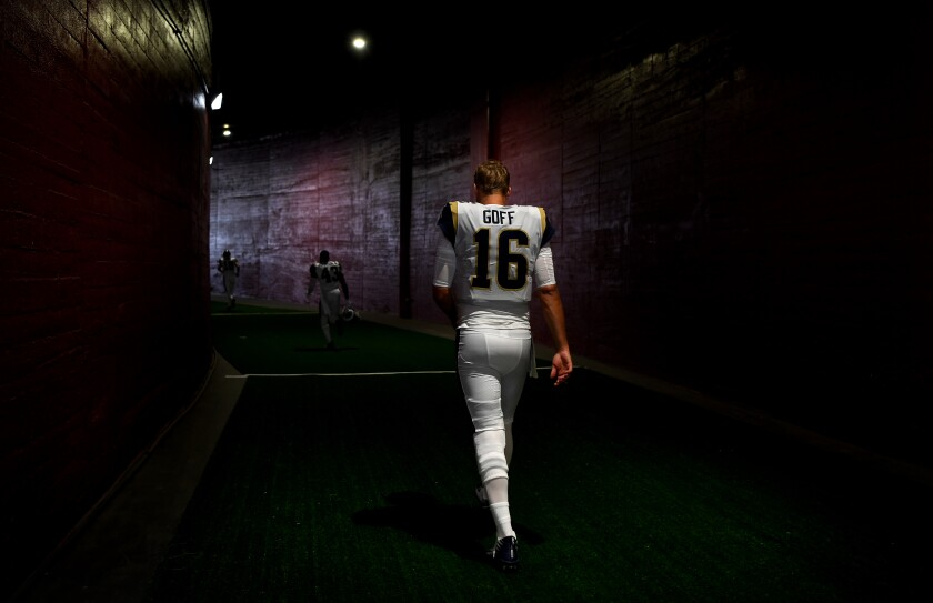 Rams quarterback Jared Goff walks through the tunnel at the Coliseum in 2019.