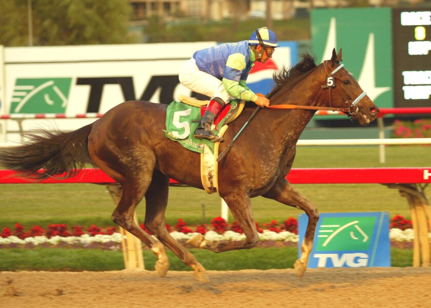 Jockey Victor Espinoza rides the Mace Siegel-owned Declan's Moon to victory in the Grade III $100,000 Hollywood Prevue Stakes on Nov. 20, 2004 at Hollywood Park.