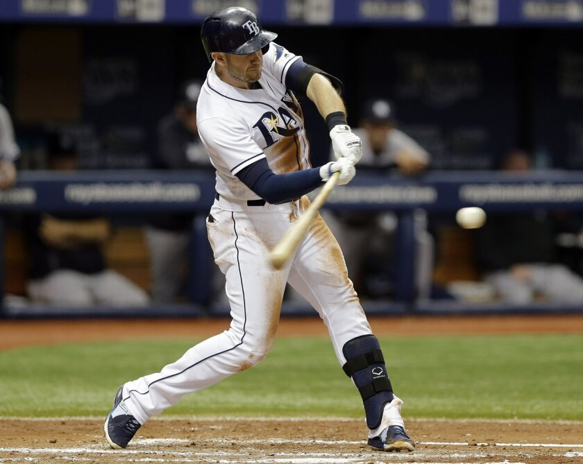 Tampa Bay Rays' Evan Longoria connects for a two-run home run off New York Yankees starting pitcher Michael Pineda during the second inning of a baseball game, Saturday, May 28, 2016, in St. Petersburg, Fla. Rays' Brad Miller also scored. (AP Photo/Chris O'Meara)