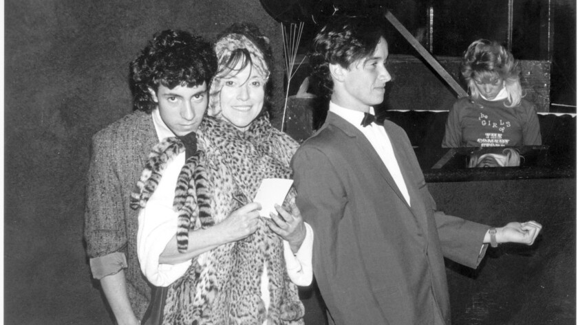 Mitzi Shore, owner of The Comedy Store, with sons Peter, left, and Pauly, right in 1986.
