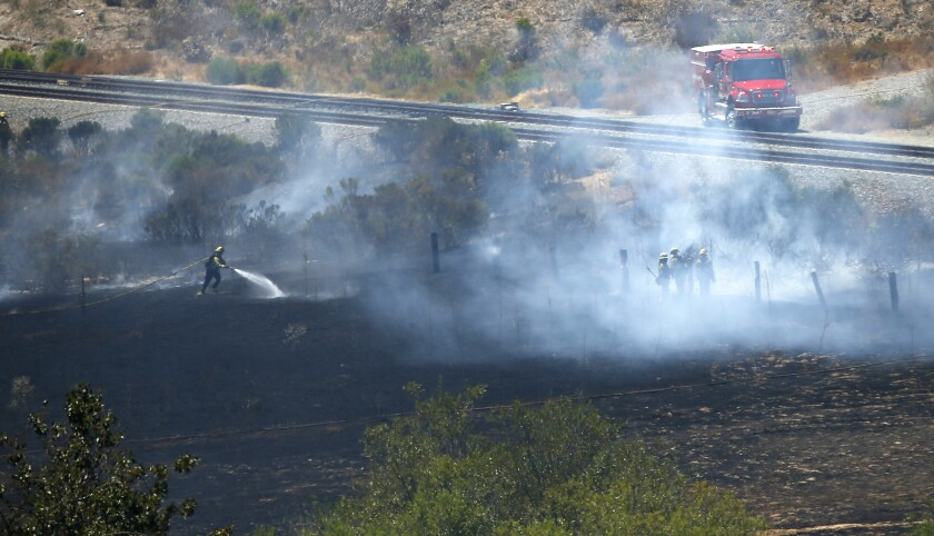 A one-acre brush fire broke out along the railroad tracks in Rose Canyon in University City on August 15, 2019. The tracks were shut down briefly while crews got the blaze under control.