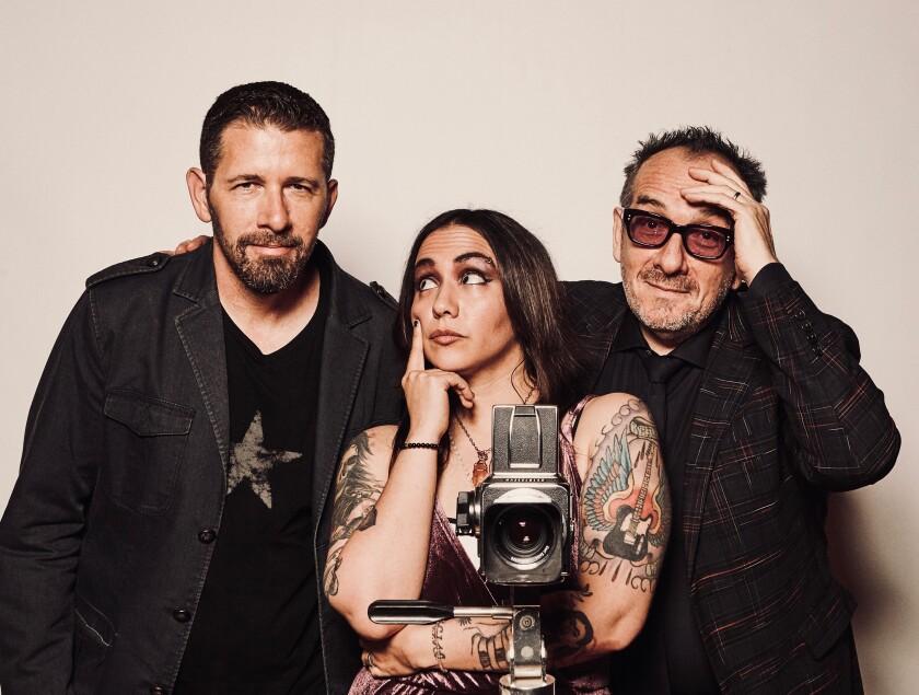 Elvis Costello, right, with Sebastian Krys, left, and Nina Diaz