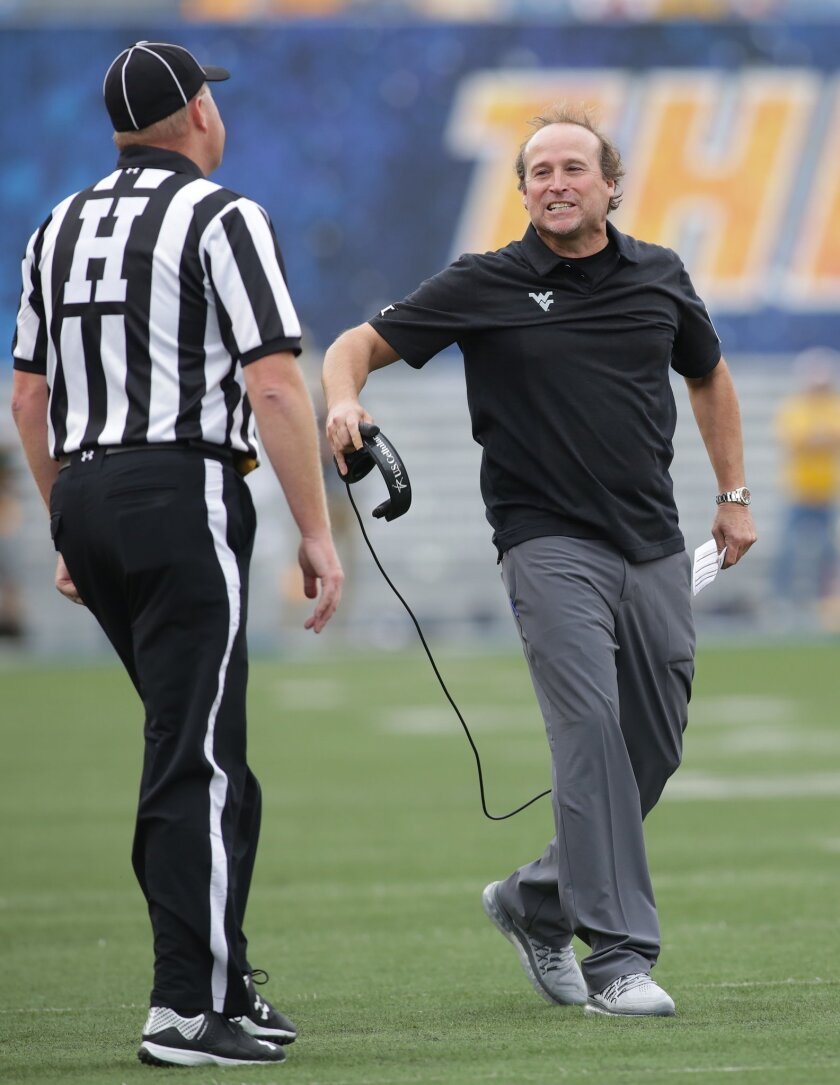 West Virginia head coach Dana Holgorsen disagrees with a call during the first half of an NCAA college football game against Maryland, Saturday, Sept. 26, 2015, in Morgantown, W.Va. West Virginia defeated Maryland 45-6. (AP Photo/Raymond Thompson)