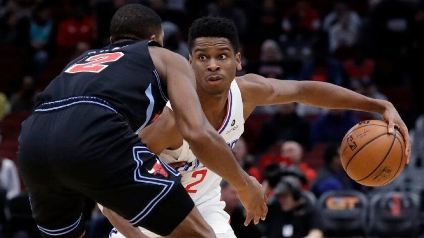 Clippers guard Shai Gilgeous-Alexander, right, controls the ball in front of Chicago Bulls forward Jabari Parker during a game on Jan. 25.