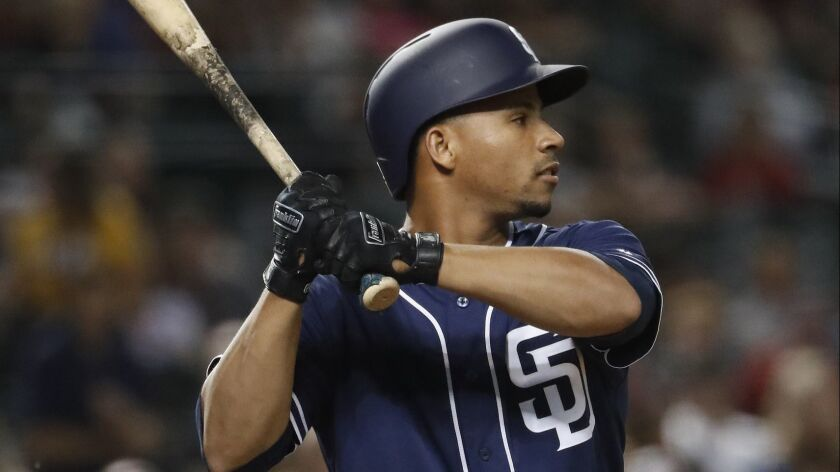 Francisco Mejia bats in his first game with the Padres on Tuesday in Arizona.