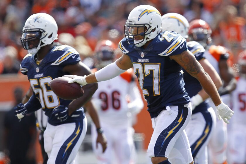 Chargers Jimmy Wilson recovers a fumble by Bengals Jeremy Hill in the 3rd quarter.