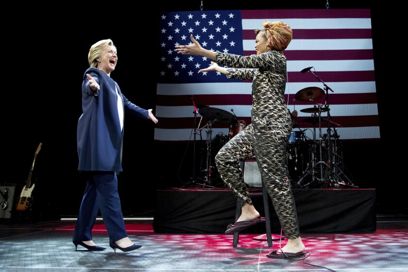 Hillary Clinton takes the stage with singer Andra Day at a fundraiser in San Francisco on Thursday.