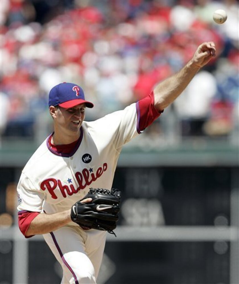 Philadelphia Phillies starting pitcher J.A. Happ throws in the second inning of a baseball game with the Pittsburgh Pirates, Sunday, July 12, 2009, in Philadelphia. (AP Photo/Tom Mihalek)