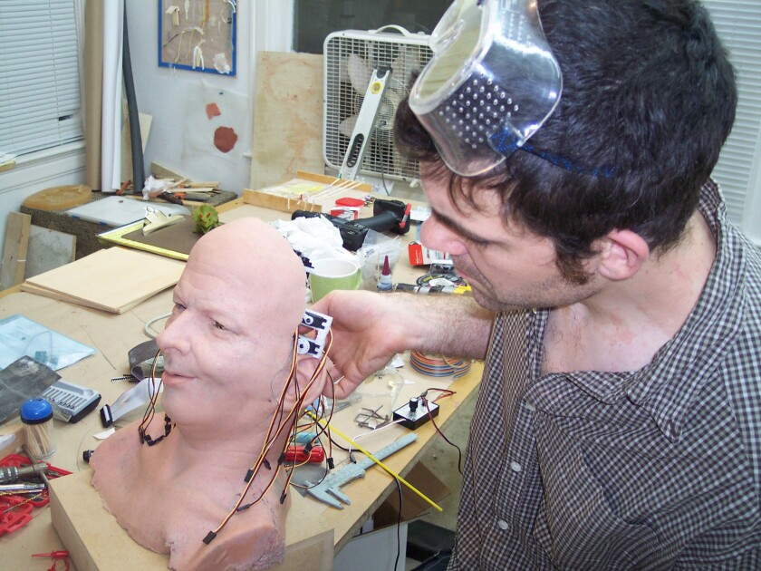 David Hanson working on the android's head. Image from the book 'How to Build an Android' by David F. Dufty.
