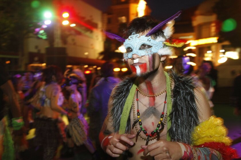 James Mikesell performed with Kruciaal (cq) Element during the Mardi Gras festival in the Gaslamp Quarter Tuesday evening.    Photo by David Brooks /  Union-Tribune MANDATORY PHOTO CREDIT: DAVID BROOKS/UNION-TRIBUNE/Zuma PRESS