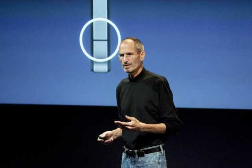 The late Steve Jobs, then Apple's chief executive, addresses iPhone 4 reception problems at a July 2010 news conference.