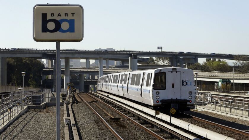 A Bay Area Rapid Transit train leaves the station in Oakland in this 2013 file photo. Regulators fined the agency $650,000 for safety failures that led to a train fatally striking two workers inspecting a track five years ago during a union strike.