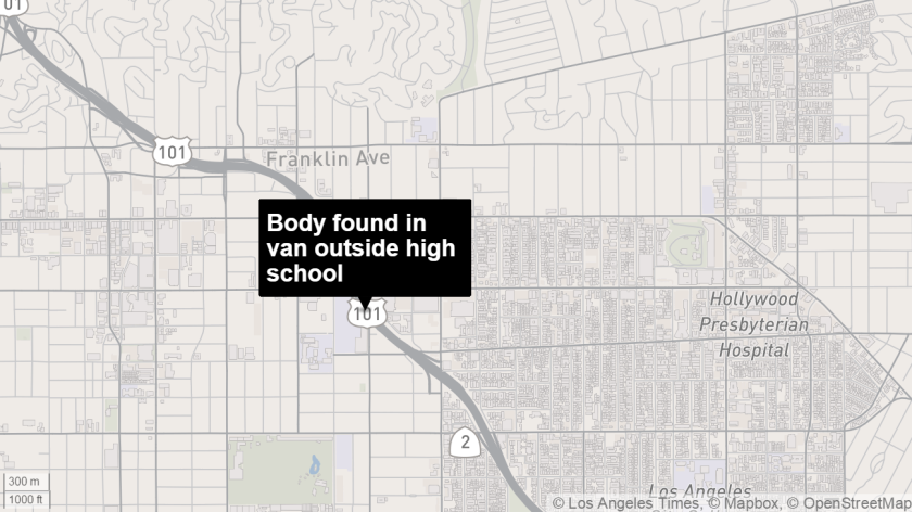 A body was found inside a van parked outside a high school in Hollywood.